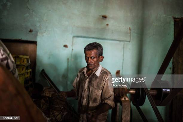 A mechanic works on a machine at the factory of the Geragama Tea Estate operated by Pussellawa Plantations Ltd in Pilimathalawa Central Sri Lanka on...