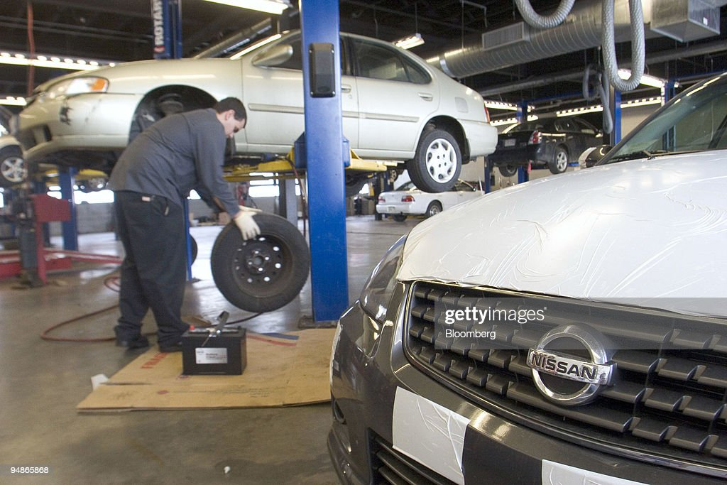 A mechanic works on a Nissan Altima at Colonial Nissan in Medford Massachusetts on Thursday February 2 2006 Shares of Nissan Motor Co Japan's...