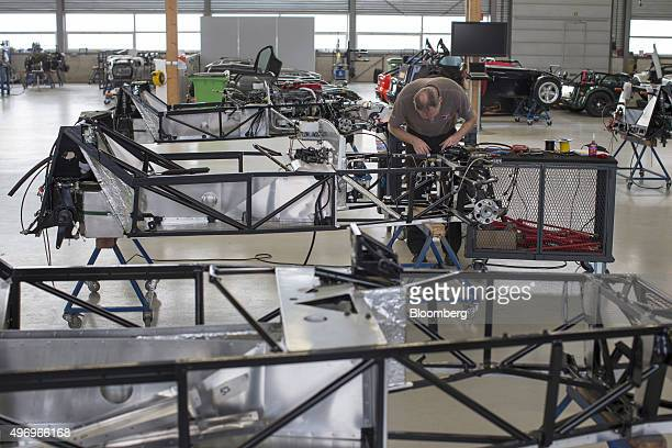 A mechanic works on the steel chassis frame of a Donkervoort D8 GTO automobile at the Donkervoort Automobielen BV manufacturing facility in Lelystad...