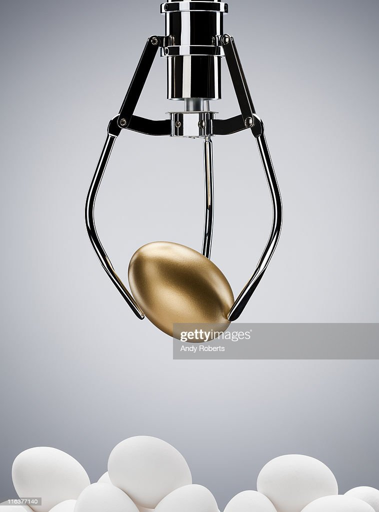 Mechanical claw lifting golden egg