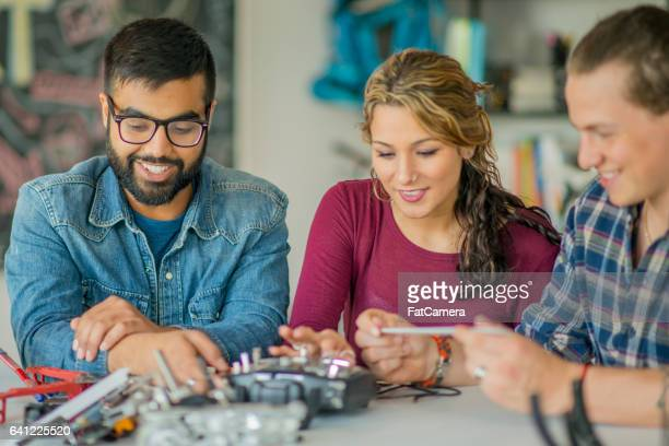 Mechanical Engineers Working on a Drone