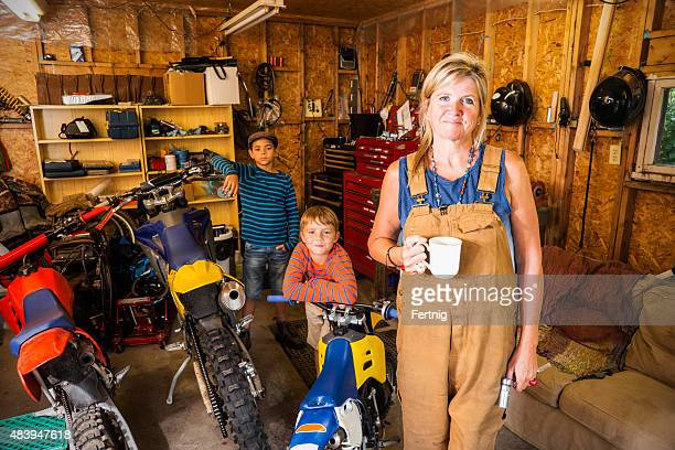 Mechanical mother with her sons in their garage