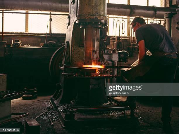 Mechanical press on a blacksmith's workshop