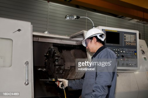 mechanical technician of cnc machine : Stock Photo