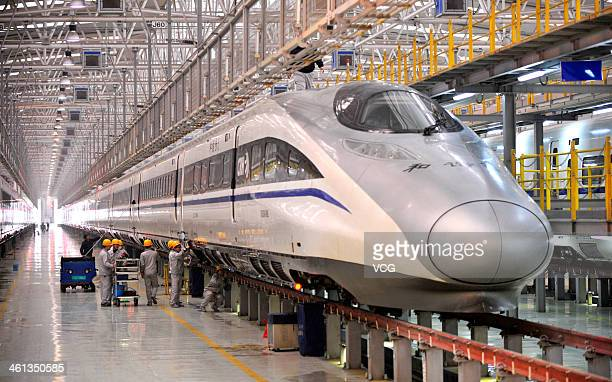 Mechanics check a highspeed train at Xi'an Electric Multiple Unit Maintenance Base on January 7 2014 in Xi An China The 40day 2014 Spring Festival...