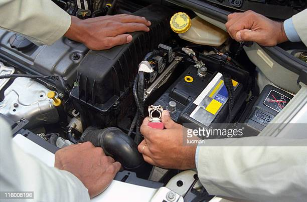 Mechanics checking the car engine