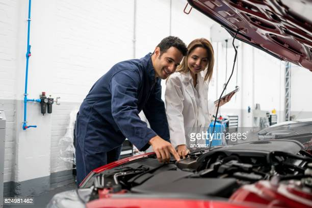 Mechanics fixing a car at a garage