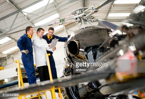 Mechanics fixing a helicopter