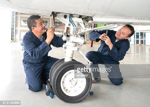 Mechanics fixing an airplane