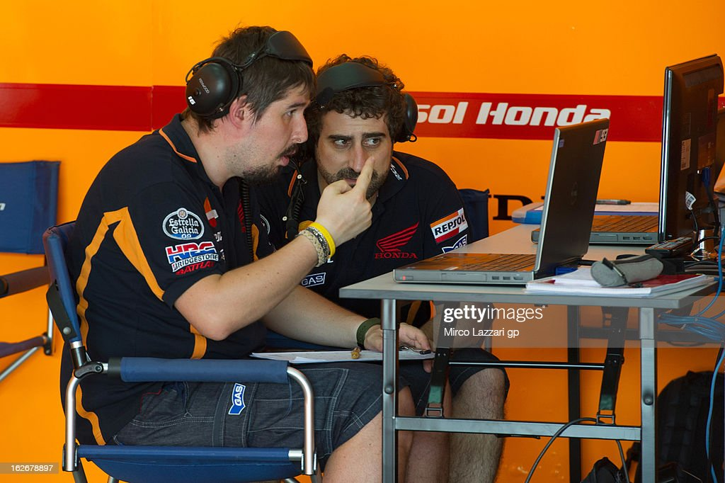 Mechanics of Marc Marquez of Spain and Repsol Honda Team speak in paddock during day one of MotoGP Tests at Sepang Circuit on February 26, 2013 in Kuala Lumpur, Malaysia.