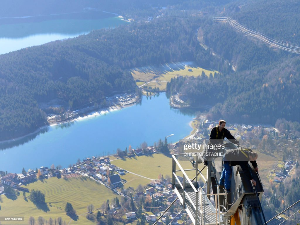 Mechanic's of the Herzogstand cable car inspect parts of the lift during the annual safety revision in front of the small village Walchensee on November 21, 2012