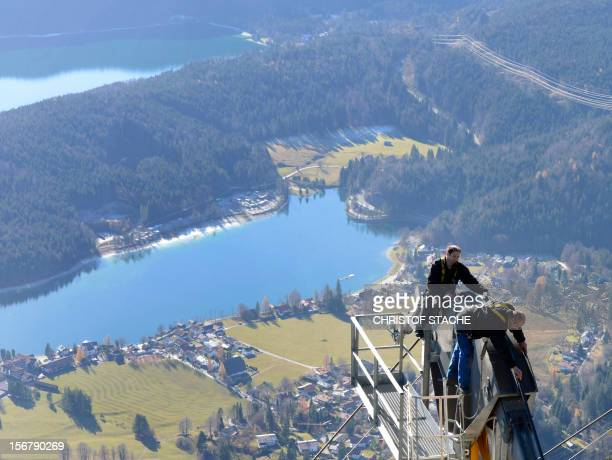 Mechanic's of the Herzogstand cable car inspect parts of the lift during the annual safety revision in front of the small village Walchensee on...