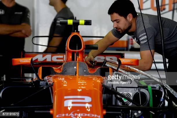 Mechanics prepares the F1 racing car of Stoffel Vandoorne of the McLaren Honda Team before the final race of F1 GP Brazil at the Jose Carlos Pace...