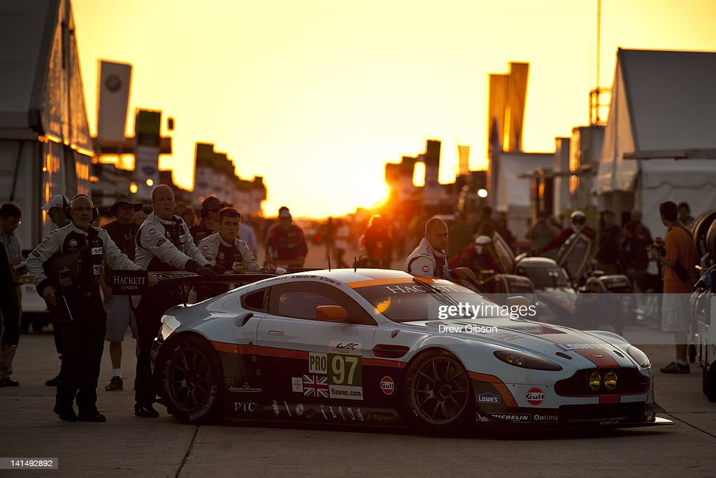 Mechanics push the Aston Martin Racing Aston Martin Vantage V8 driven by Stefan Mucke of Germany, <a gi-track='captionPersonalityLinkClicked' href=/galleries/search?phrase=Adrian+Fernandez&family=editorial&specificpeople=167077 ng-click='$event.stopPropagation()'>Adrian Fernandez</a> of Mexico and <a gi-track='captionPersonalityLinkClicked' href=/galleries/search?phrase=Darren+Turner&family=editorial&specificpeople=235550 ng-click='$event.stopPropagation()'>Darren Turner</a> of England to the pit lane during the 2012 World Endurance Championship - 12 Hours Of Sebring at Sebring International Raceway on March 17, 2012 in Sebring, Florida.