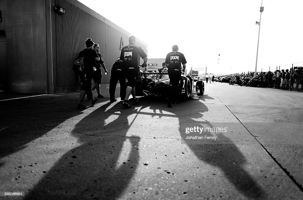 Mechanics push the car of Graham Rahal through the garage before the 100th Running of the Indianapolis 500 Mile Race at Indianapolis Motorspeedway on May 29, 2016 in Indianapolis, Indiana.