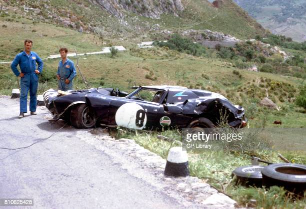 Mechanics survey wreckage of Ferrari 250LM at Targa Florio