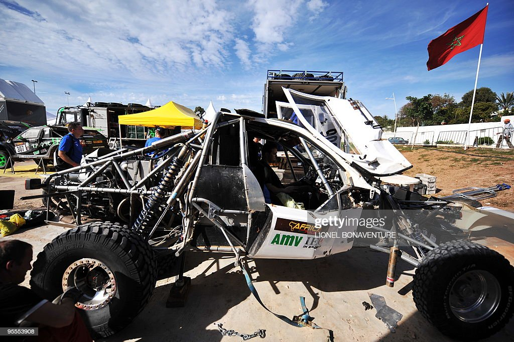 Mechanics work on French driver Gilles Florin's car in the bivouac in Agadir, during a rest day of the second edition of the Africa Eco Race, on Juanuary 3, 2010. The Africa Eco Race started on December 30, 2009 in Nador, Morocco, and continues over 11 days and 6,000 kilometres through Mauritania to lac Rose in Senegal.