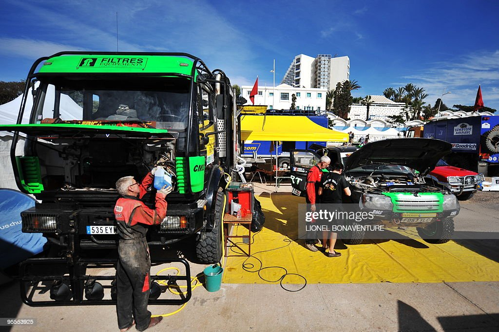 Mechanics work on French driver Vincent Demonceaux's car and assistance truck in the bivouac in Agadir, during a rest day of the second edition of the Africa Eco Race, on Juanuary 3, 2010. The Africa Eco Race started on December 30, 2009 in Nador, Morocco, and continues over 11 days and 6,000 kilometres through Mauritania to lac Rose in Senegal.