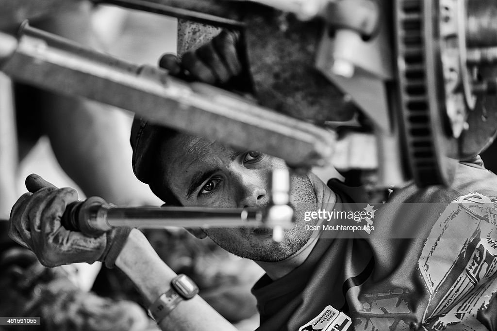 Mechanics work on the car of (#315) Christian Lavieille and Jean-Pierre Garcin of France for the Haval Rally Team during Day 4 of the 2014 Dakar Rally on January 8, 2014 in Chilecito, Argentina.