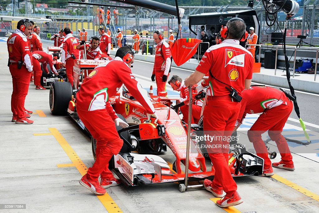 Mechanics work on the car of Scuderia Ferrari's Finnish driver Kimi Raikkonen during the first practice session of the Formula One Russian Grand Prix at the Sochi Autodrom circuit on April 29, 2016. / AFP / ALEXANDER