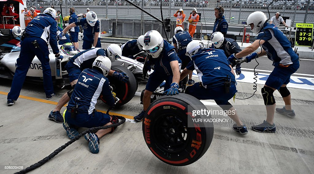 Mechanics work on the car of Williams Martini Racing's Brazilian driver Felipe Massa during the third practice session of the Formula One Russian Grand Prix at the Sochi Autodrom circuit on April 30, 2016. / AFP / YURI