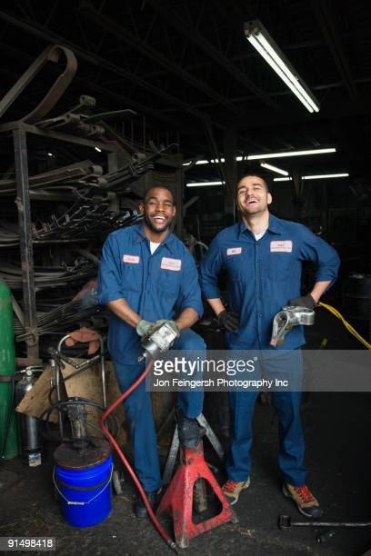Mechanics working together in repair shop