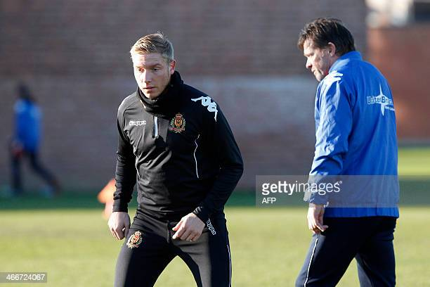 KV Mechelen football club's new recruit Jonathan Legear and Mechelen's coach Franky Vercauteren take part in a training session of his team in...