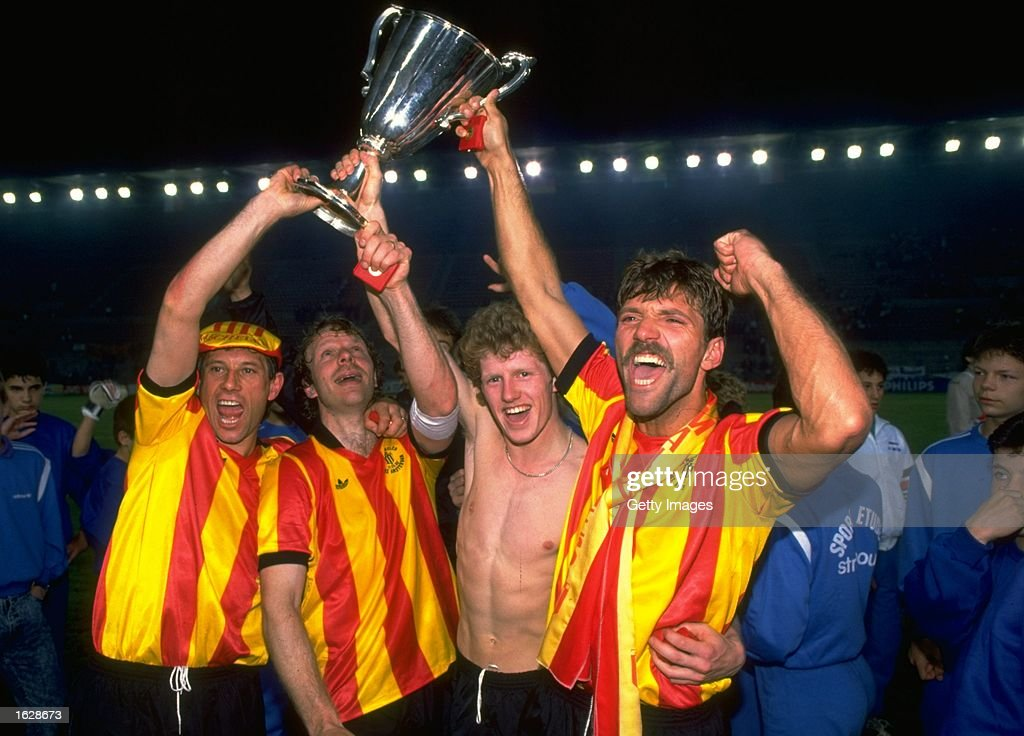 Mechelen players celebrate with the trophy after their victory in the European Cup Winners Cup final against Ajax at the Stade de la Meinau in...
