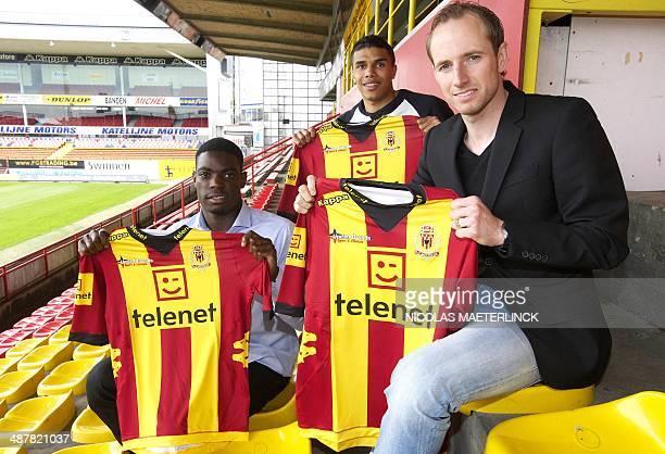 KV Mechelen's new signings Stevy Okitokandjo Jason Adesanya and Tim Matthys pose with their new shirts during a press conference at KV Mechelen's...