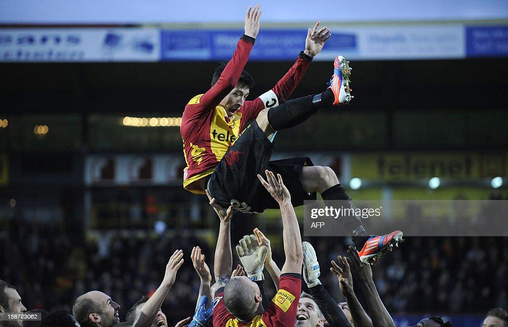 Mechelen's Xavier Chen is honored by his team mates after the Jupiler Pro League match between KV Mechelen and KAA Gent in Mechelen on December 26...