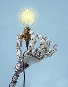 Hi-tech hand holding a classic light bulb