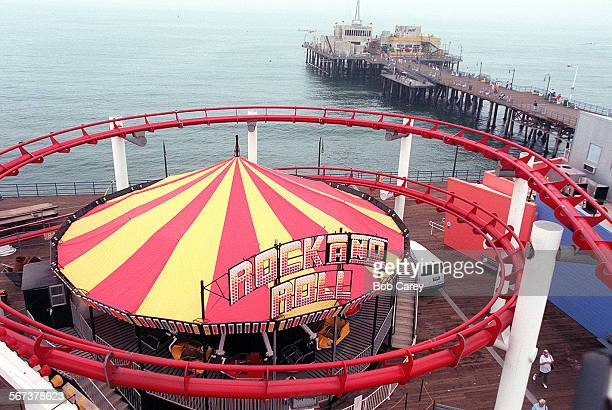 MECoaster#20809BC/c–––The red tracks of the West Coaster wrap around the Rock and Roll ride on the Santa Monica Pier Workers are putting the...