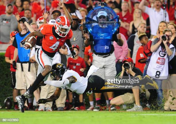 Mecole Hardman of the Georgia Bulldogs runs with a catch for a touchdown against Thomas Wilson of the Missouri Tigers at Sanford Stadium on October...