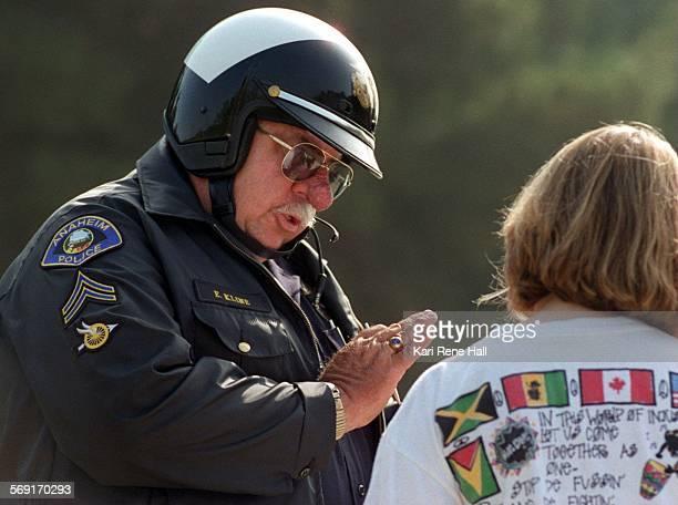 MECopmotorist3KH10/15/96Officer Ed Kline cautions Carolyn Scharpen of Anaheim about watching her downhill speed Kline wrote her a ticket after...