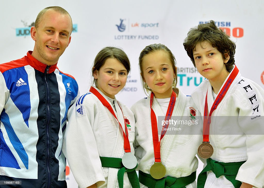 Medal ceremony for the Pre Cadet Girls Under 32kgs category accompanied by Visually Impaired Judo World Champion and London Paralympic bronze medallist, Ben Quilter, who presented the medals: