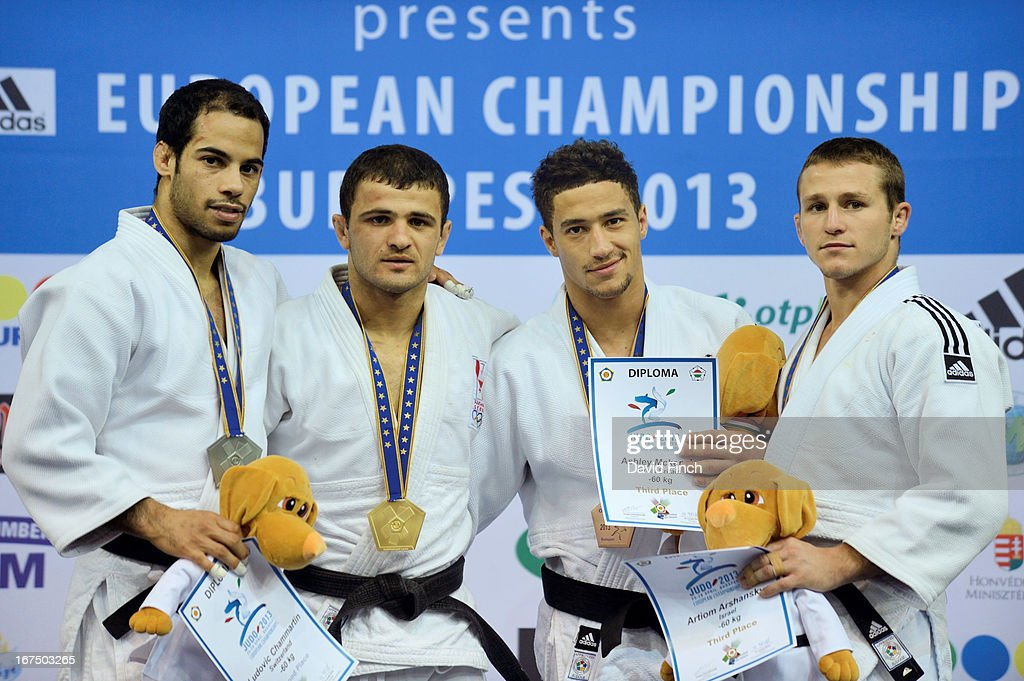 Medal ceremony for u60kgs category (L-R) Silver medalist Ludovic Chammartin of Georgia, Gold medalist Amiran Papinashvili of Georgia, Bronze medalists Ashley McKenzie of Great Britain and Artiom Arshansky of Israel at the Budapest European Championships held at the Papp Laszlo Sports Hall on April 25, 2013 in Budapest, Hungary.