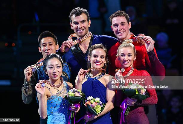 A medal ceremony is held for the pairs free skating final with gold medalists Meagan Duhamel and Eric Radford of Canada silver medalists Wenjing Sui...