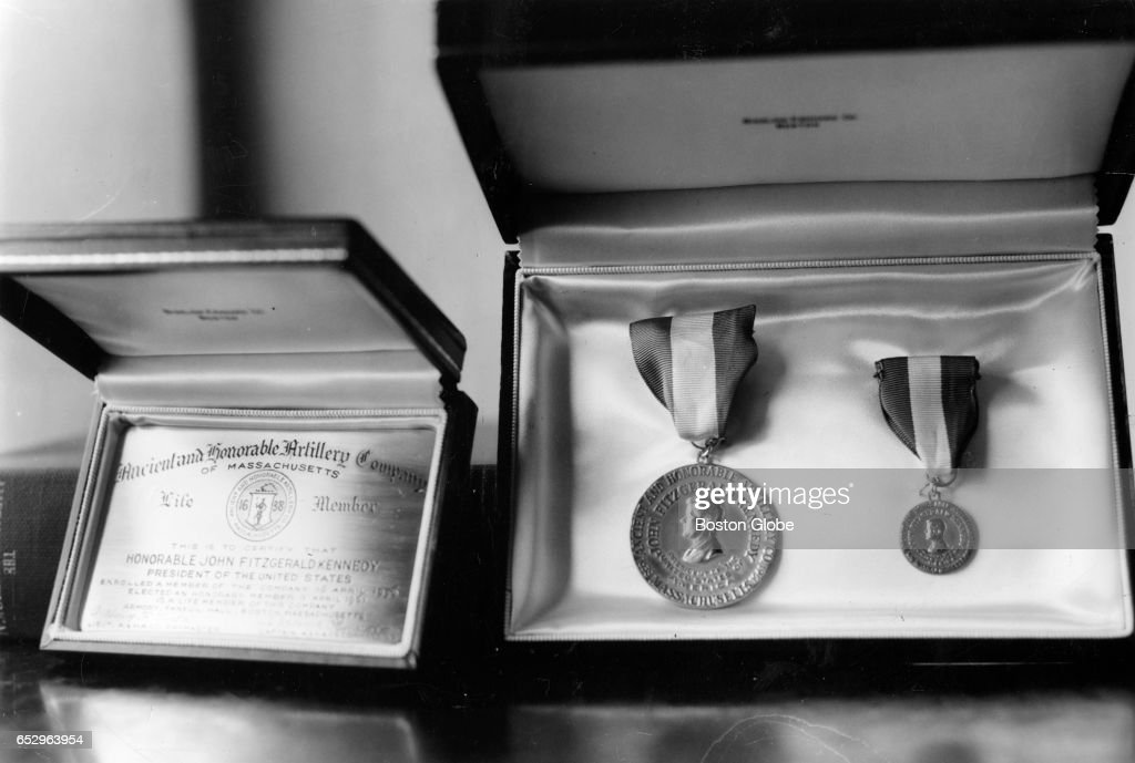 A medal featuring President John F. Kennedy's profile and a gold lifetime membership card, gifts for the president's birthday from the Ancient and Honorable Artillery Co. of Boston, are pictured on May 24, 1961.
