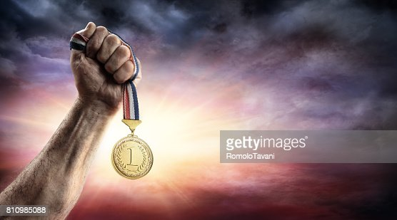 Medal Of First Place In Hand - Victory Concept - Medal 3d Rendering : Stock Photo