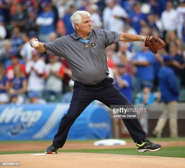 Medal of Honor recipient James McCloughan throws a ceremonial first pitch before the Chicago Cubs take on the Cincinnati Reds at Wrigley Field on...