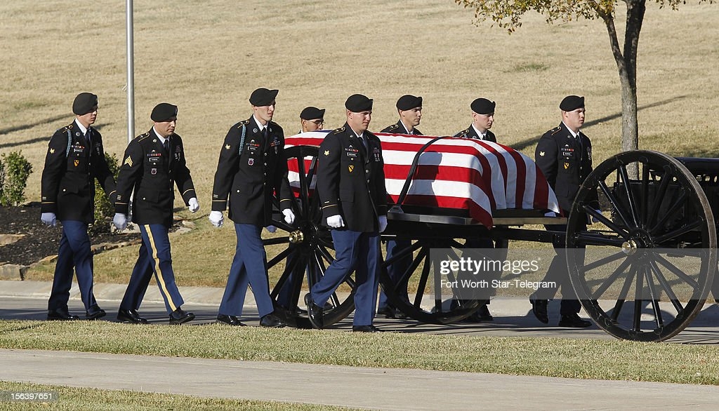 Medal of Honor recipient retired Col. James L. Stone's casket is carried into the burial service at the DFW National Cemetery in Dallas, Texas, on Wednesday, November 14, 2012.