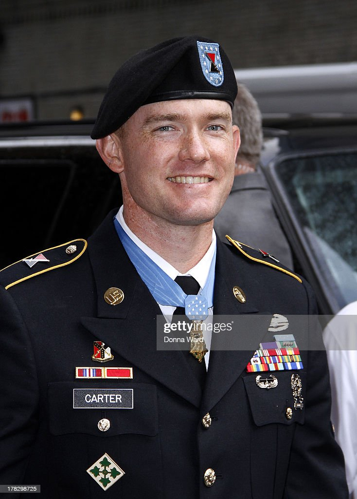 Medal of Honor Recipient Staff Sgt Ty Carter leaves the 'Late Show with David Letterman' at Ed Sullivan Theater on August 28, 2013 in New York City.