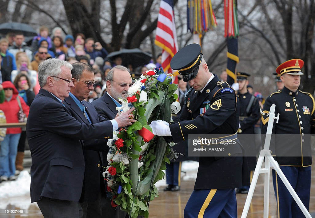 Medal of Honor recipients (L) place a wreath at the Tomb of the Unknows at the Arlington National Cemetery in Arlington, Virginia, on March 25, 2013 to mark the 150th anniversary of Medal of Honor, the nation's highest award for wartime acts of valor. AFP PHOTO/Jewel Samad