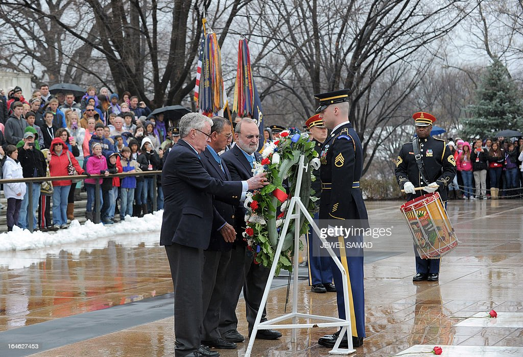 Medal of Honor recipients place a wreath at the Tomb of the Unknows at the Arlington National Cemetery in Arlington, Virginia, on March 25, 2013 to mark the 150th anniversary of Medal of Honor, the nation's highest award for wartime acts of valor. AFP PHOTO/Jewel Samad