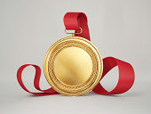 gold medal isolated on a grey background