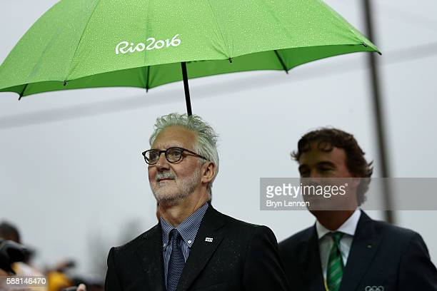 Medal presenter and ICO member Camiel Eurlings and gift presenter and UCI president Brian Cookson are seen during the medal ceremony for the Cycling...