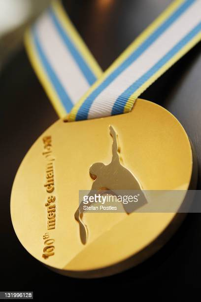 A medal to commemorate 2012 as the 100th time the men's single championship will be contested is on show during the Australian Open Trophy Tour at...