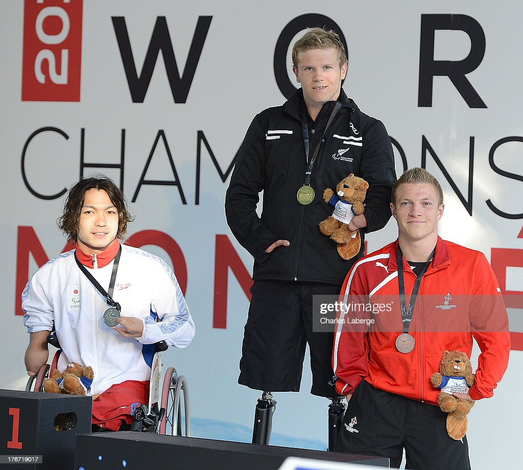 Medal Winners for the Men's 510M Individual Medley SM4 Final (L-R)Takayuki Suzuki of Japan(Silver),<a gi-track='captionPersonalityLinkClicked' href=/galleries/search?phrase=Cameron+Leslie&family=editorial&specificpeople=5525988 ng-click='$event.stopPropagation()'>Cameron Leslie</a> of New Zealand(Gold) and Jonas Larsen of Denmark(Bronze) pose with their medals during day six of the IPC Swimming World Championships at Parc Jean Drapeau on August 17, 2013 in Montreal, Canada.
