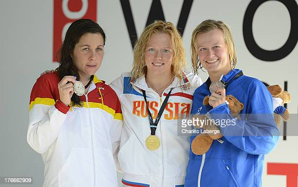 Medal winners for the Women's 400M Freestyle S12 Final Deborah Font of Spain Darya Stukalova of Russia and Hannah Russel of Great Britain pose with...