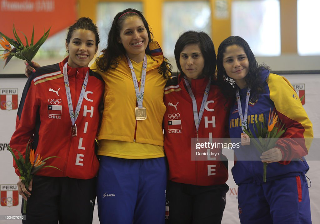 Medal winners, from left, Paula Silva, of Chile, silver, Saskia Loretta Van Erven Garcia, of Colombia, gold, Barbara Garcia, of Chile, bronze, and Liz Rivera, of Venezuela, bronco pose for pictures on the podium after competing in fencing event as part of the XVII Bolivarian Games Trujillo 2013 at Colegio San JosŽ Obrero Coliseum on November 18, 2013 in Trujillo, Peru.